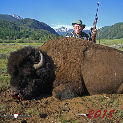 Hunter with his Trophy Bison