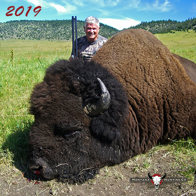 Hunter with a bison